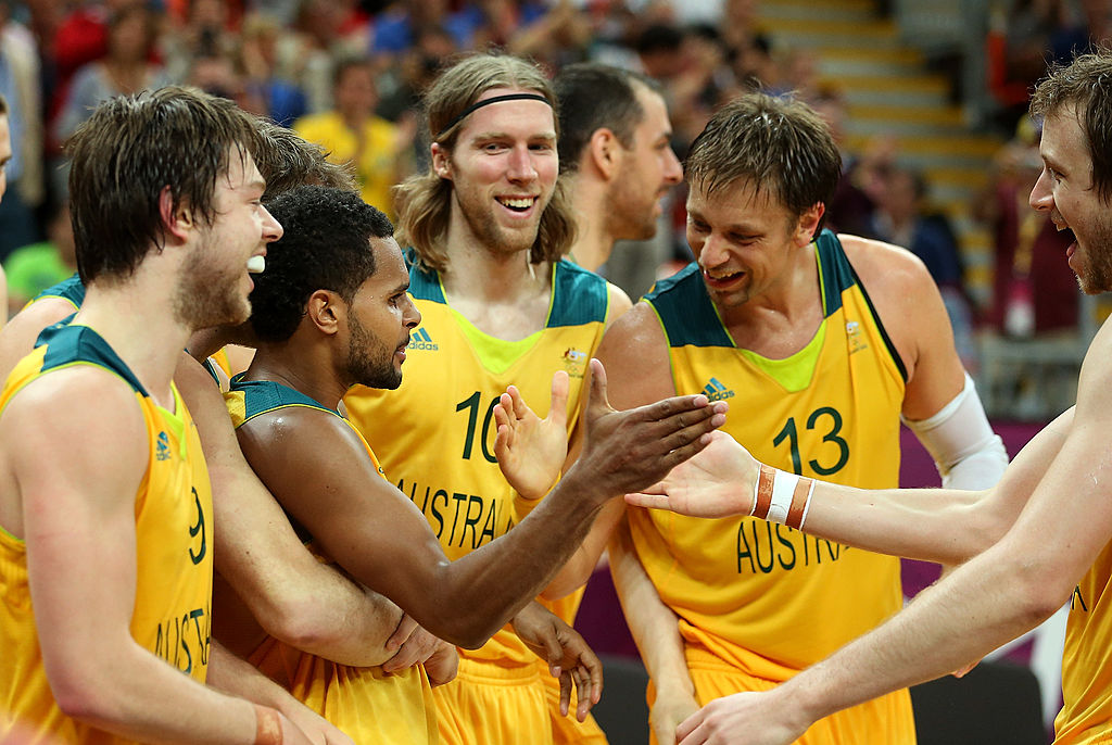 LONDON, ENGLAND - AUGUST 06: Patrick Mills #5 of Australia celebrates with David Barlow #10, David Andersen #13 and Joe Ingles #7 after making the game winning three point shot against Russia in the final seconds of the Men's Basketball Preliminary Round match on Day 10 of the London 2012 Olympic Games at the Basketball Arena on August 6, 2012 in London, England. (Photo by Christian Petersen/Getty Images)